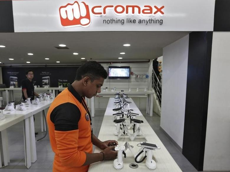 An employee stands at the counter of Micromax mobile phones at a showroom in New Delhi December 6, 2013. REUTERS/Adnan Abidi