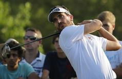 Alejandro Canizares of Spain tees off on the 15th hole during the third round of the DP World Tour Championship in Dubai in this file photo taken on November 16, 2013.   REUTERS/Ahmed Jadallah