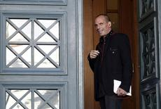 Greece's Finance Minister Yanis Varoufakis speaks on his phone upon arriving for a government meeting at the parliament building in Athens February 7, 2015.  REUTERS/Kostas Tsironis