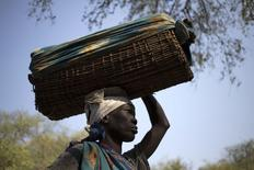 A woman carries her baby, suspected to be suffering from kala azar, in a basket to a Medecins Sans Frontieres/Doctors Without Borders (MSF) facility in Lankien, South Sudan, January 14, 2015.