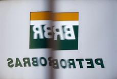 The Petrobras logo is reflected in the window of the company's headquarters in Sao Paulo February 6, 2015. REUTERS/Paulo Whitaker