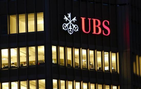 UBSが2014年配当を増額、第4四半期利益は予想上回る