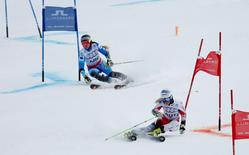 Feb 10, 2015; Vail, CO, USA; Eva-Maria Brem of Austria (right) races Salome Bancora of Argentina in the first round in the Nations Team Event during the FIS alpine skiing world championships at Golden Peak Stadium. Mandatory Credit: Jerry Lai-USA TODAY Sports
