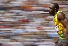 Usain Bolt of Jamaica runs on his way to winning his 100m heat round 1 during the London 2012 Olympic Games at the Olympic Stadium August 4, 2012.    REUTERS/Phil Noble