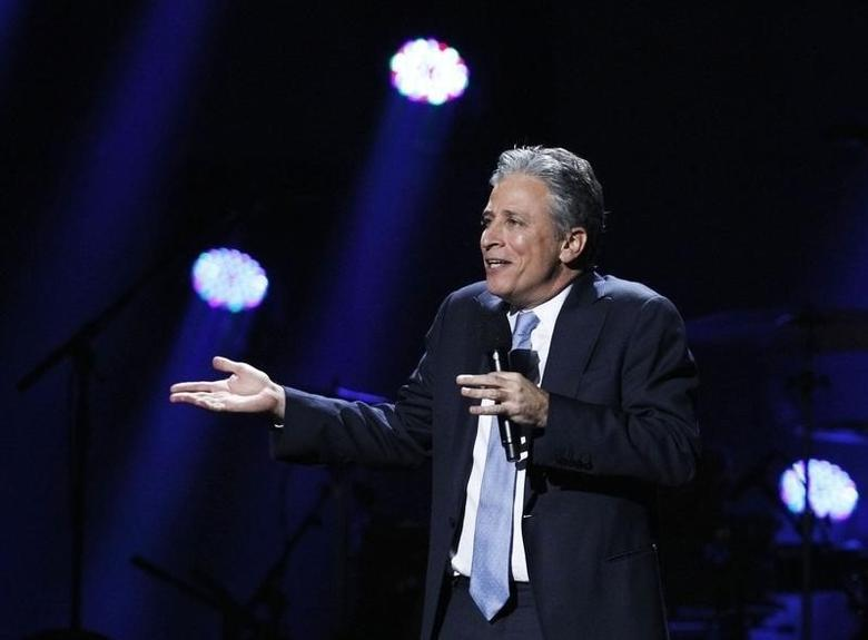 Comedian Jon Stewart speaks during the ''12-12-12'' benefit concert for victims of Superstorm Sandy at Madison Square Garden in New York December 12, 2012.  REUTERS/Lucas Jackson