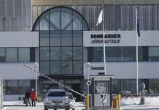 Employees leave work at a Bombardier plant in Montreal, January 21, 2014. REUTERS/Christinne Muschi