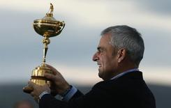 Captain Paul McGinley poses with the Ryder Cup after the closing ceremony of the 40th Ryder Cup at Gleneagles in Scotland in this file photo taken on September 28, 2014. REUTERS/Phil Noble