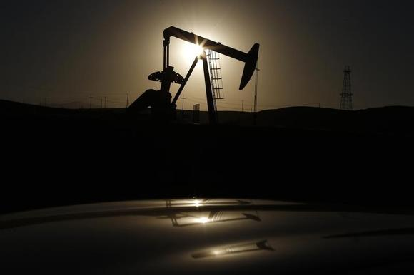 A pump jack is seen at sunrise near Bakersfield, California October 14, 2014. REUTERS/Lucy Nicholson