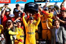 Feb 22, 2015; Daytona Beach, FL, USA; NASCAR Sprint Cup Series driver Joey Logano (22) celebrate with Harley J. Earl Trophy after winning the Daytona 500 at Daytona International Speedway. Mandatory Credit: Jasen Vinlove-USA TODAY Sports