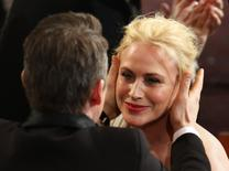 "Patricia Arquette is congratulated by actor Ethan Hawke after winning the Oscar for Best Supporting Actress for her role in ""Boyhood""  at the 87th Academy Awards in Hollywood, California February 22, 2015.  REUTERS/Mike Blake"