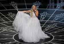 """Lady Gaga performs songs from """"The Sound of Music"""" during the 87th Academy Awards in Hollywood, California February 22, 2015. REUTERS/Mike Blake"""