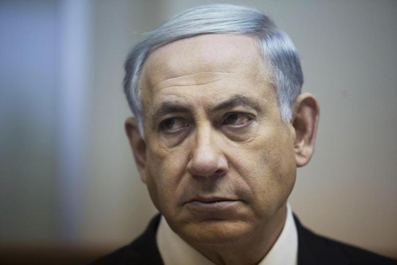 Israel's Prime Minister Benjamin Netanyahu attends the weekly cabinet meeting at his office in Jerusalem, February 15, 2015.  REUTERS/Abir Sultan/Pool