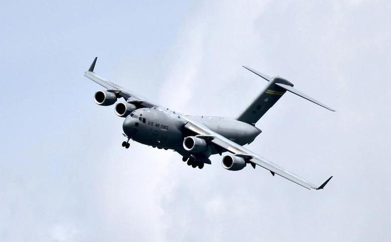 A Boeing C-17 Globemaster III military transport aircraft of the United States Air Force (USAF) performs a fly-by during the Singapore Airshow in Singapore February 15, 2012.  REUTERS/Tim Chong