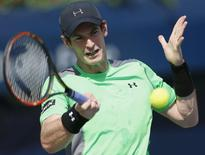 Andy Murray of Britain returns the ball to Joao Sousa of Portugal during their match at the ATP Championships tennis tournament in Dubai, February 25, 2015. REUTERS/Ahmed Jadallah