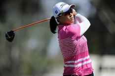 Apr 5, 2014; Rancho Mirage, CA, USA; Amy Yang tees off on the third hole in the third round of the Kraft Nabisco Championship golf tournament at Mission Hills Country Club. Mandatory Credit: Kelvin Kuo-USA TODAY Sports