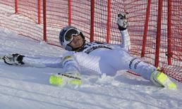 Lindsey Vonn of the U.S. lands into the security net after crashing during the women's giant slalom of the Alpine Skiing World Cup in Maribor February 21, 2015.                   REUTERS/Srdjan Zivulovic