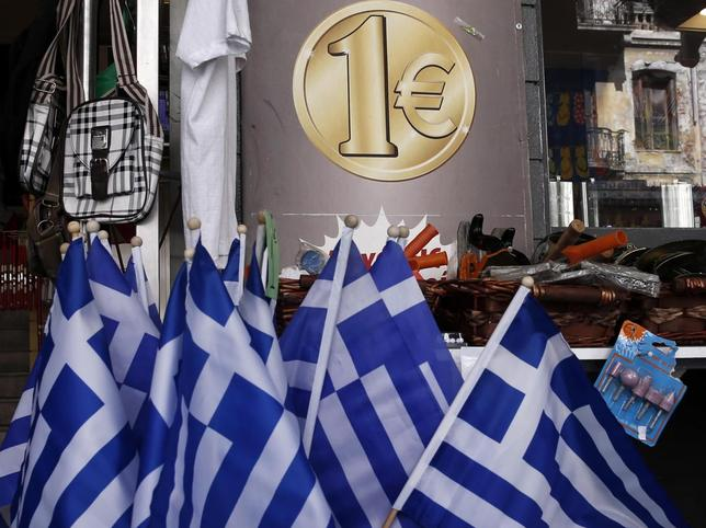 Greek national flags are displayed for sale at the entrance of a one Euro shop in Athens March 2, 2015. REUTERS/Alkis Konstantinidis