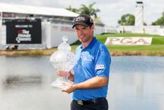 Mar 2, 2015; Palm Beach Gardens, FL, USA; Padraig Harrington celebrates winning the Honda Classic at PGA National GC Champion Course. Peter Casey-USA TODAY Sports