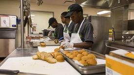Students prepare food in a kitchen in this July 18, 2013 handout photo provided by Liberty's Kitchen in New Orleans, Louisiana, March 3, 2015.   REUTERS/Liberty's Kitchen/Handout via Reuters