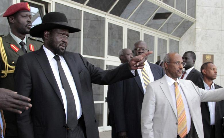 South Sudan's President Salva Kiir Mayardit (L) gestures as he leaves after attending peace talks with the South Sudanese rebels in Ethiopia's capital Addis Ababa, March 6, 2015. REUTERS/Tiksa Negeri