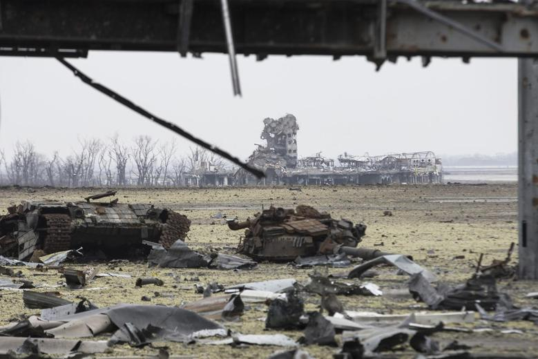 A Ukrainian army tank destroyed in fighting with the separatist self-proclaimed Donetsk People's Republic army lies outside a terminal at Donetsk airport March 3, 2015. REUTERS/Baz Ratner
