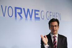 Bernhard Guenther, Chief Financial Officer of German power supplier RWE AG, attends the company's annual results news conference in the western German city of Essen March 10, 2015. Germany's second biggest utilities on Tuesday reported its 2014 full-year results that is afflicted by tumbling power prices as a result of weak demand, overcapacity and the German energy transition that favours renewable energy.     REUTERS/Wolfgang Rattay