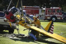 Actor Harrison Ford's damaged airplane is taken away after its crash landing at Penmar Golf Course in Venice, Los Angeles California March 6, 2015. REUTERS/Lucy Nicholson