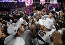 New England Patriots players celebrate with the Vince Lombardi Trophy after defeating the Seattle Seahawks in Super Bowl XLIX at University of Phoenix Stadium. Mandatory Credit: Mark J. Rebilas-USA TODAY Sports