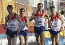 Russia's (from L) Sergey Morozov, Vladimir Kanaykin, Valeriy Borchin and Andrey Ruzavin compete during the men's 20km race walk at the IAAF World Race Walking Cup in Saransk May 12, 2012.  REUTERS/Sergei Karpukhin