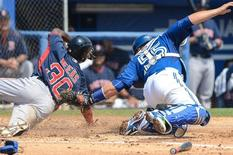 Mar 19, 2015; Dunedin, FL, USA;  Boston Red Sox second baseman Jemile Weeks (30)  slides safely into home plate as Toronto Blue Jays catcher Russell Martin (55) attempts to tag him in the third inning of the spring training game  at Florida Auto Exchange Park. Mandatory Credit: Jonathan Dyer-USA TODAY Sports