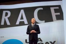 """Starbucks Corp Chief Executive Howard Schultz, pictured with images from the company's new """"Race Together"""" project behind him, speaks during the company's annual shareholder's meeting in Seattle, March 18, 2015.   REUTERS/David Ryder"""