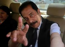 Sahara Group Chairman Subrata Roy gestures as he arrives at the Securities and Exchange Board of India (SEBI) headquarters in Mumbai in this April 10, 2013 file photo.  REUTERS/Danish Siddiqui/Files