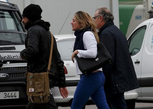 People believed to be family members of those killed in Germanwings plane crash arrive at Barcelona's El Prat airport March 24, 2015. REUTERS-Gustau Nacarino