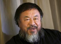 Dissident Chinese artist Ai Weiwei speaks during an interview with Reuters at his hotel in Beijing March 24, 2015. REUTERS/Kim Kyung-Hoon