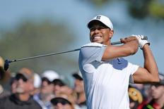 Tiger Woods hits his drive on the 12th during the first round of the Farmers Insurance Open golf tournament at Torrey Pines Municipal Golf Course - South Co. Feb 5, 2015; La Jolla, CA, USA;  Jake Roth-USA TODAY Sports