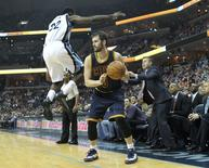 Mar 25, 2015; Memphis, TN, USA; Cleveland Cavaliers forward Kevin Love (0) drives against Memphis Grizzlies forward Jeff Green (32) in the second half at FedExForum. Cleveland defeated Memphis 111-89. Mandatory Credit: Nelson Chenault-USA TODAY Sports