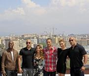 "The cast members of ""Fast and Furious 5"" (L-R) Tyrese Gibson, Vin Diesel, Elsa Pataky, Paul Walker, Gal Gadot and Dwayne Johnson pose during a photocall at the premiere of the film in Marseille in this April 28, 2011 file photo. REUTERS/Jean-Paul Pelissier"