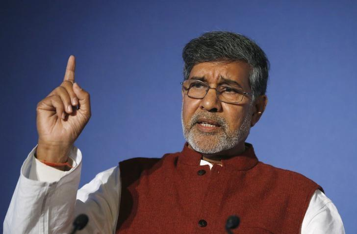 Nobel peace laureate and children's rights activist Kailash Satyarthi gestures while speaking at the Trust Women conference in London November 19, 2014. REUTERS/Suzanne Plunkett/Files