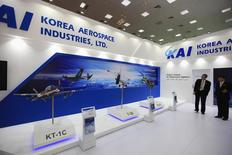 Officials stand at Korean aircraft industry Korea Aerospace Industries (KAI) booth at the Baghdad International Fair for Defence and Security, March 1, 2014. REUTERS/Ahmed Saad