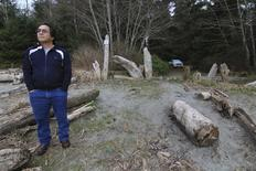 Huu-ay-aht councillor Jack Cook stands on beach in the aboriginal village of Anacla, British Columbia near to the site a proposed liquefied natural gas export terminal at Sarita Bay.  REUTERS/Julie Gordon