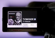 A print screen of the hacked Facebook page of French television network TV5Monde is seen on a camera viewer in Paris, April 9, 2015. REUTERS/Christian Hartmann