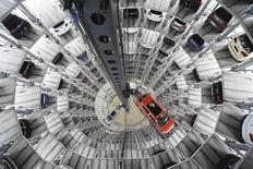 A VW Golf VII car (R) and a VW Passat are loaded in a delivery tower at the plant of German carmaker Volkswagen in Wolfsburg, March 3, 2015.  REUTERS/Fabian Bimmer