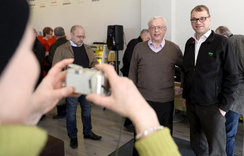 Juha Sipila (R), leader of Finnish Centre Party, posing for a photo with a Finnish citizen during campaigning for the upcoming parliamentary elections in Vantaa, April 9, 2015. Finland's parliamentary elections will be held on April 19, 2015. Picture taken April 9, 2015. REUTERS/Jussi Nukari/Lehtikuva          ATTENTION EDITORS - THIS IMAGE HAS BEEN SUPPLIED BY A THIRD PARTY. IT IS DISTRIBUTED, EXACTLY AS RECEIVED BY REUTERS, AS A SERVICE TO CLIENTS. NO THIRD PARTY SALES. NOT FOR USE BY REUTERS THIRD PARTY DISTRIBUTORS. FINLAND OUT. NO COMMERCIAL OR EDITORIAL SALES IN FINLAND.