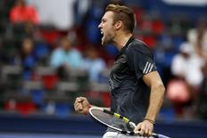 Jack Sock of the U.S. reacts after winning a point during his men's singles tennis match against Kei Nishikori of Japan at the Shanghai Masters tennis tournament in Shanghai in this file photo taken on October 8, 2014. REUTERS/Aly Song