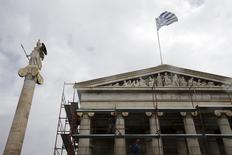Workers remove scaffolding from the Athens Academy building next to a statue of Goddess Athena (L) March 23, 2015.  REUTERS/Alkis Konstantinidis