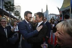 """Cast member Chris Evans (L) and actor Jeremy Renner greet each other at the premiere of """"Captain America: The Winter Soldier"""" at El Capitan theatre in Hollywood, California March 13, 2014. REUTERS/Mario Anzuoni"""