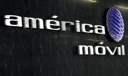 The logo of America Movil is seen on the wall of the reception area in the company's new corporate offices in Mexico City February 8, 2011. REUTERS/Henry Romero