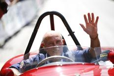 Former English Formula One driver Stirling Moss waves to spectators as he sits in his 1955 Ferrari 750 Monza during the Ennstal Classic rally near the Austrian village of Groebming July 20, 2013. REUTERS/Leonhard Foeger