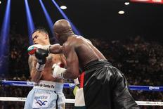 Marcos Maidana (L) of Argentina is punched by Floyd Mayweather Jr. of the U.S. during their WBC/WBA welterweight unification fight at the MGM Grand Garden Arena in Las Vegas, Nevada, May 3, 2014. REUTERS/Steve Marcus