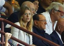 Former Italian Prime Minister Silvio Berlusconi sits in the tribune near his daughter Barbara during the Italian Serie A soccer match between AC Milan and Lazio at the San Siro stadium in Milan, August 31, 2014.  REUTERS/ Stefano Rellandini